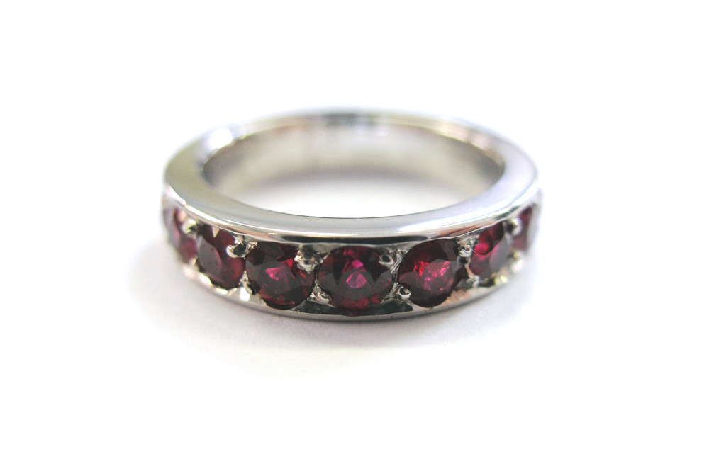 Platinum wedding ring with bead set rubies