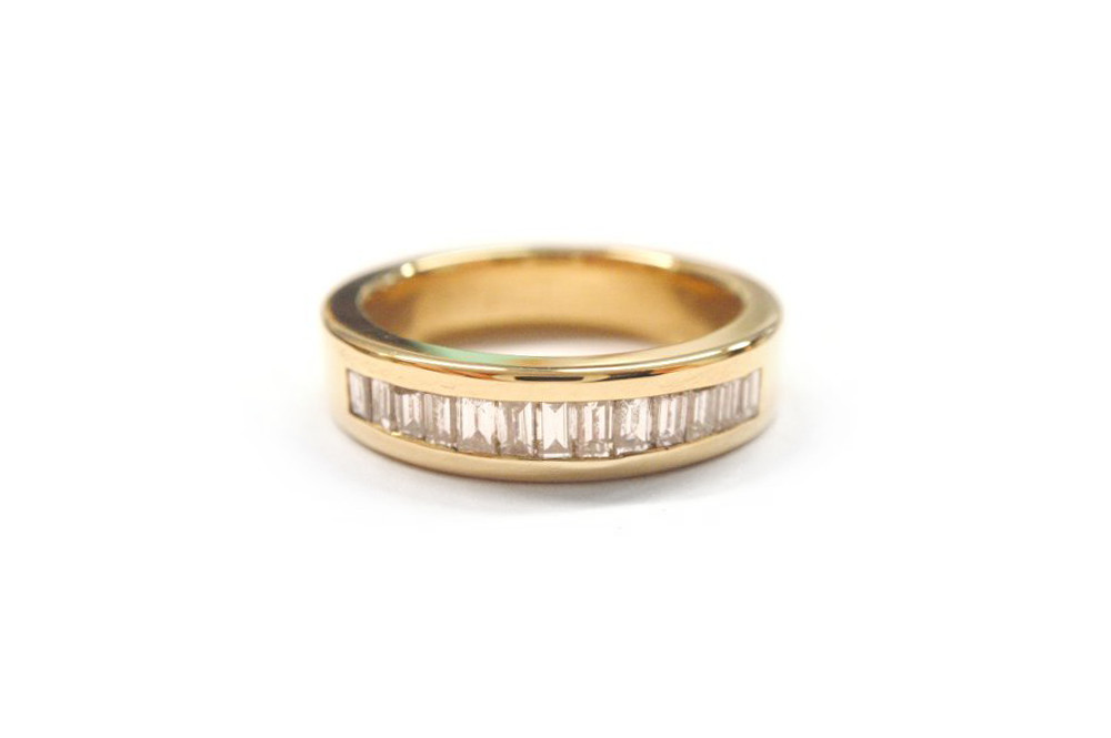 Baguette diamonds channel set in yellow gold band