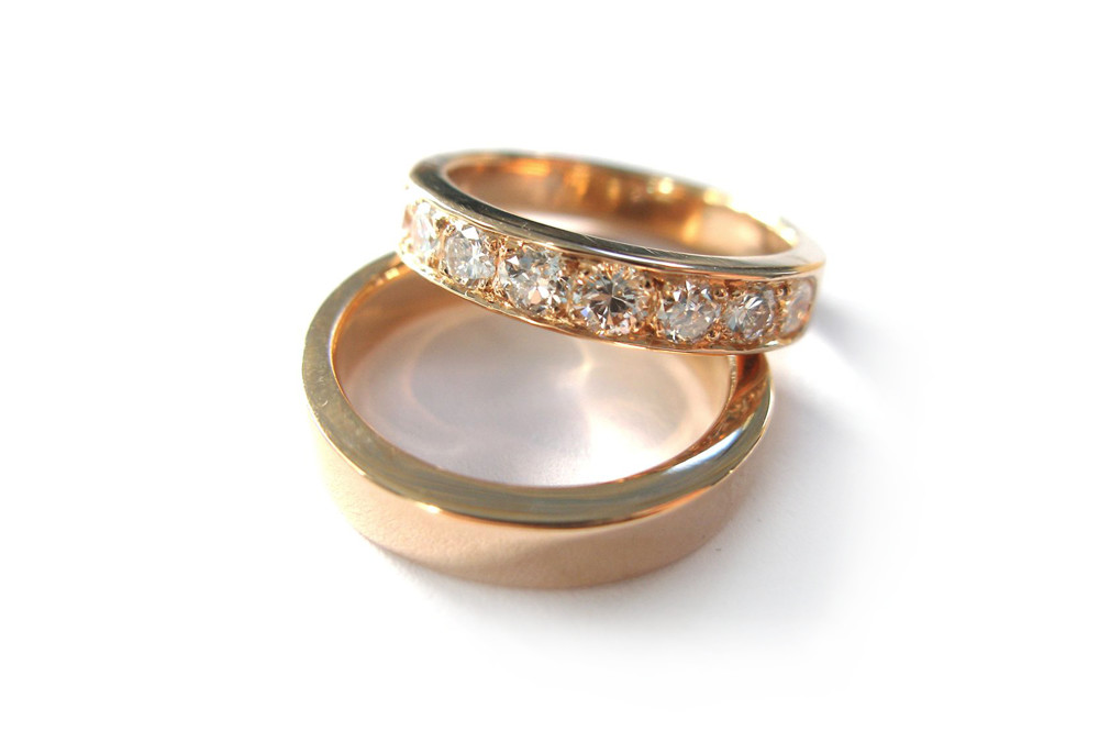 Rose gold wedding set with pave set brilliant cut diamonds and plain band