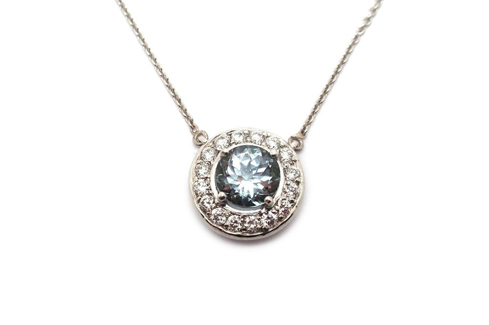 Aquamarine claw set with a diamond halo pendant
