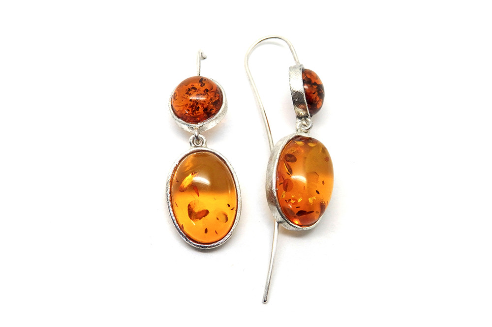 Amber cabochon drop earrings set in silver
