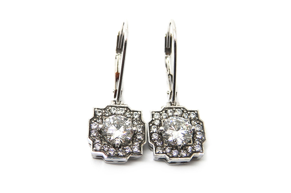 Diamond claw set with surrounding smalls in an art deco design hinged earrings