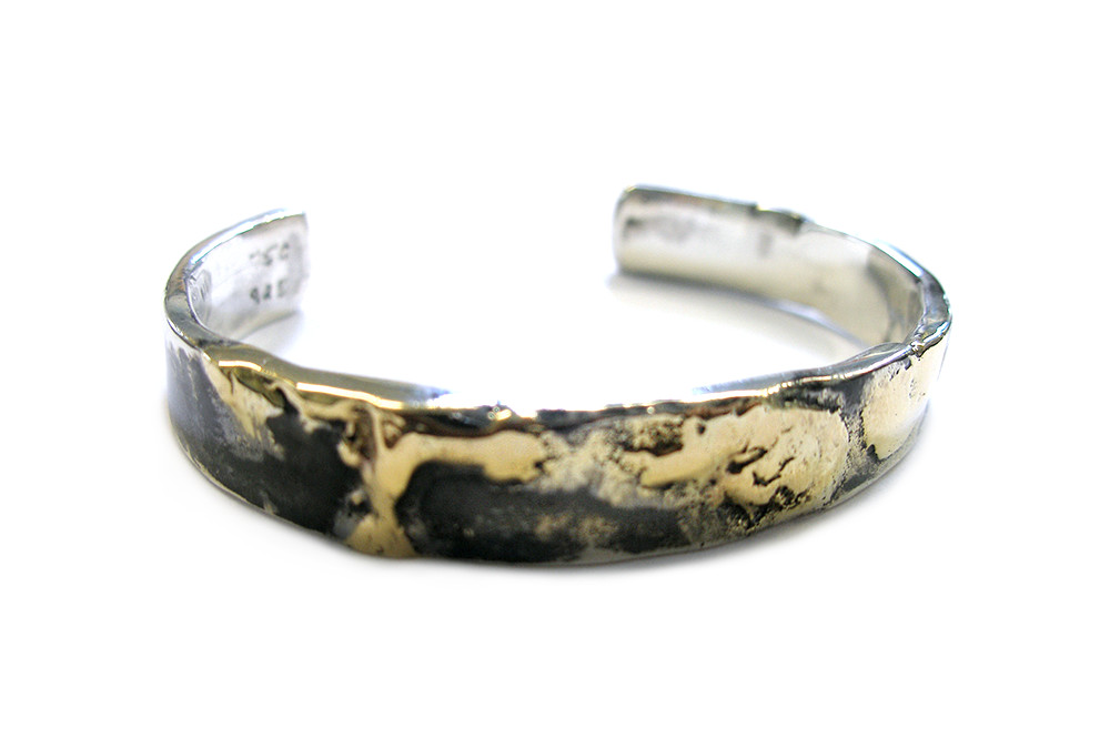 Mens cuff with  gold melted into to sterling silver with blackened finish