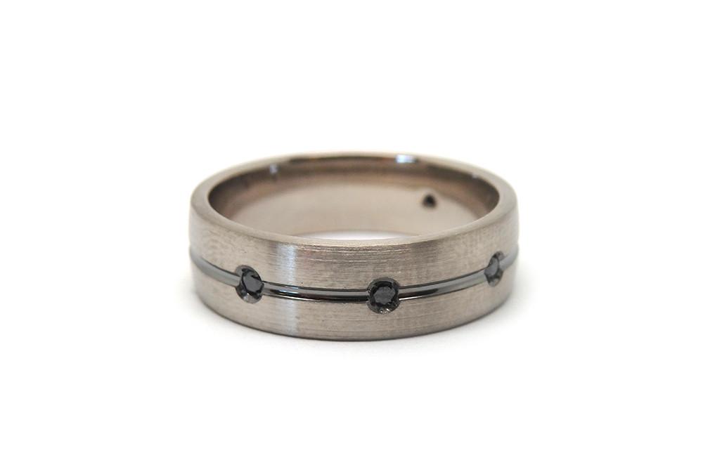 Men's brush finished white gold ring with black diamonds