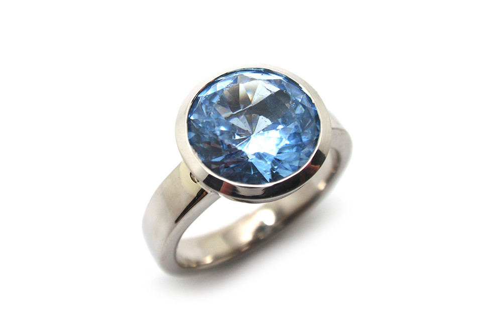 Large blue spinel bezel set dress ring