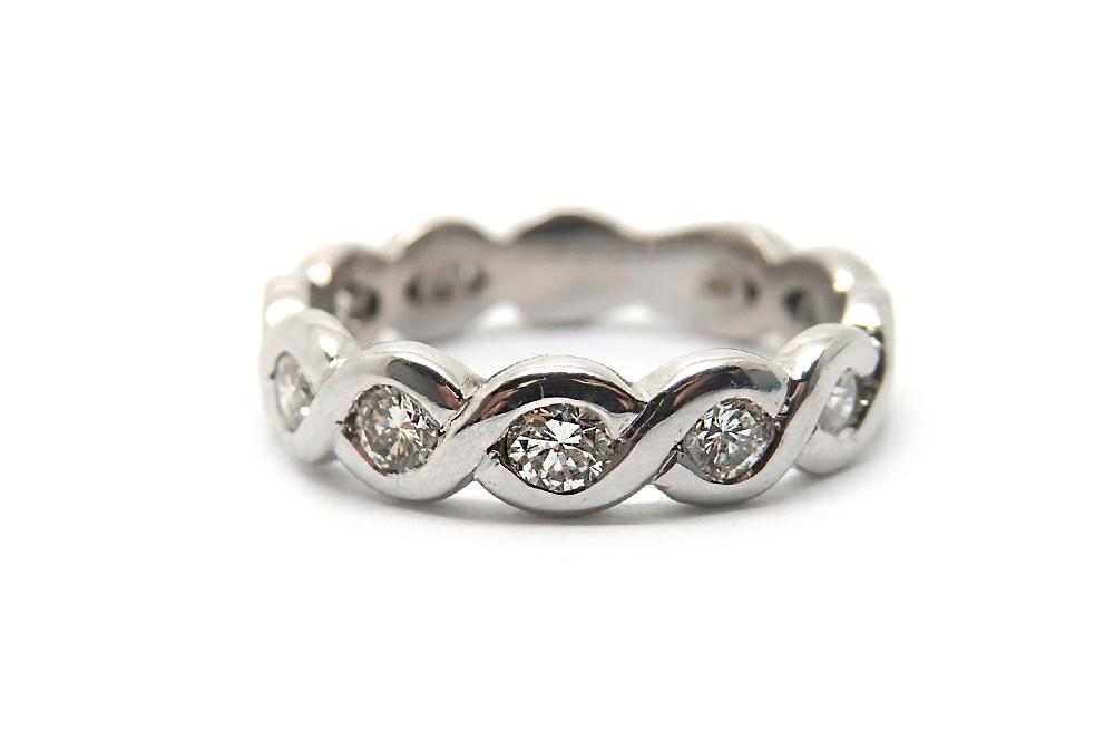 Woven metal and diamond dress ring