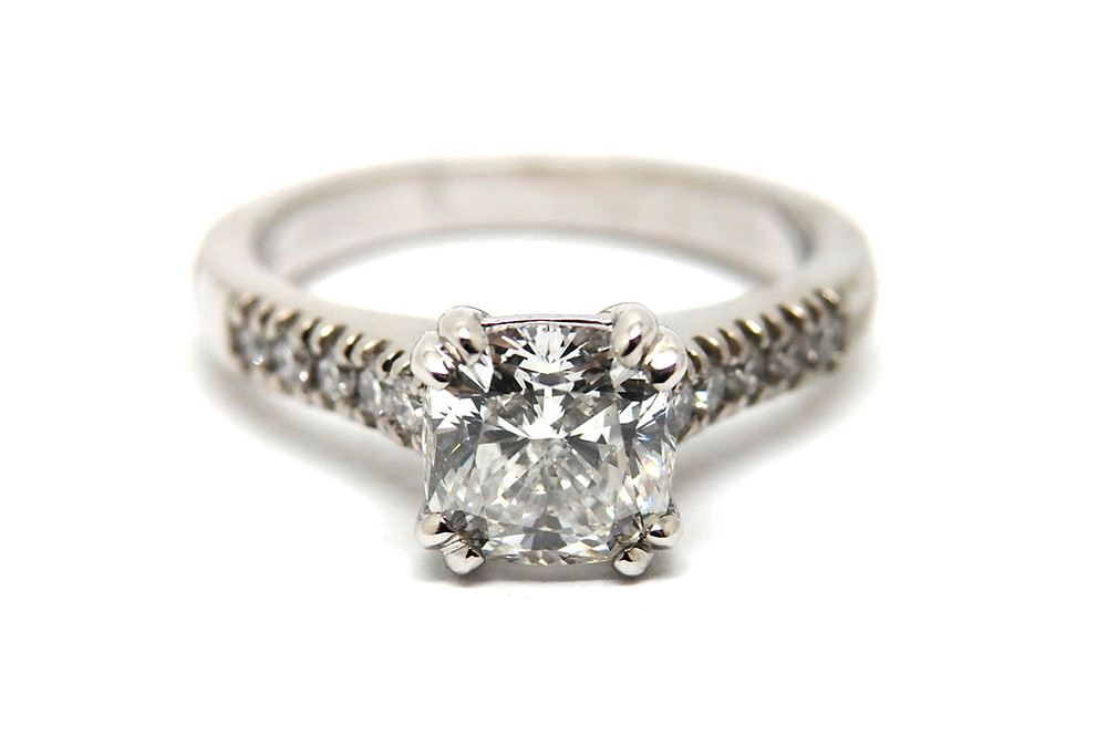Split claw square cushion cut diamond ring with double claw shoulder stones