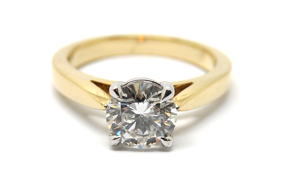 Classic four claw solitaire diamond ring