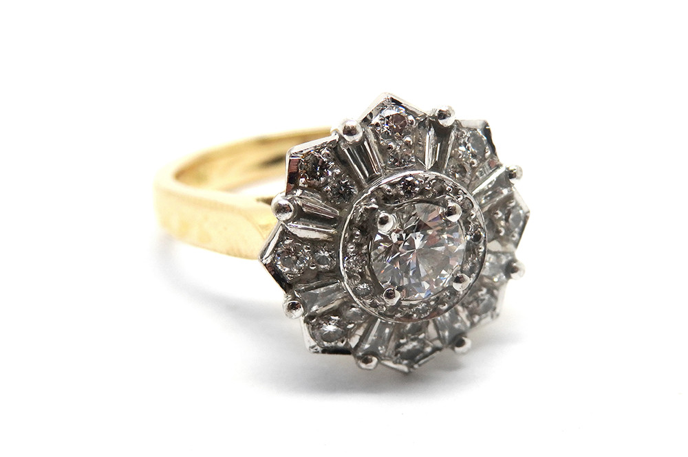 Art deco inspired diamond ring with various sized brilliant cut diamonds and baguettes bead and claw set