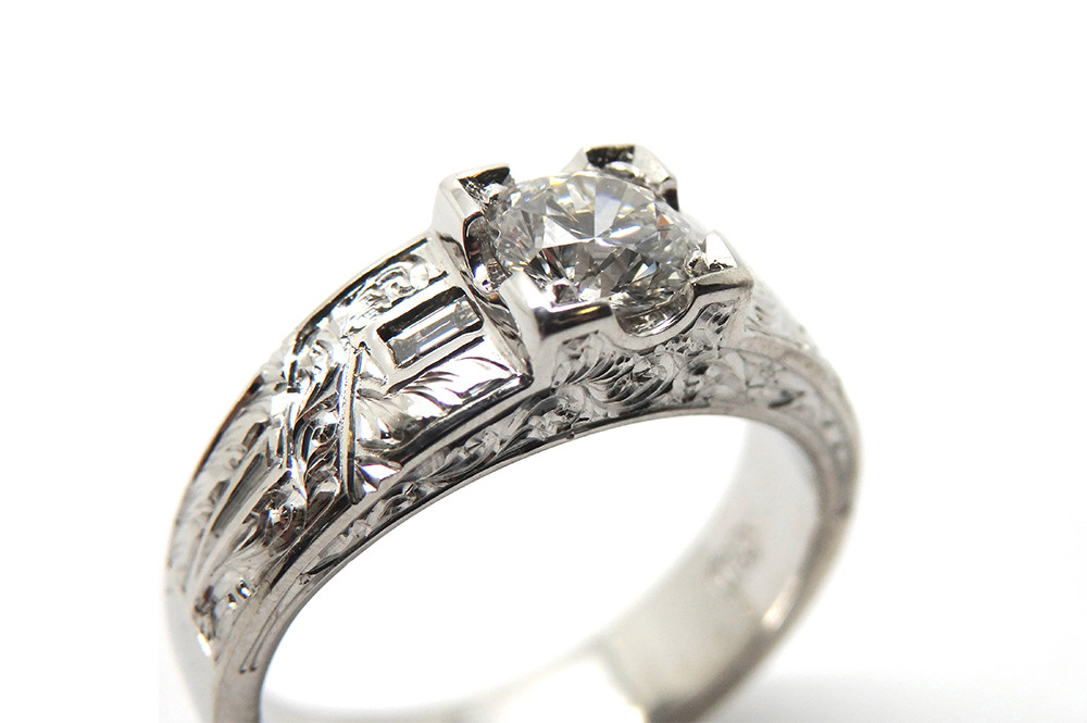Art deco inspired diamond engagement ring with hand engraving