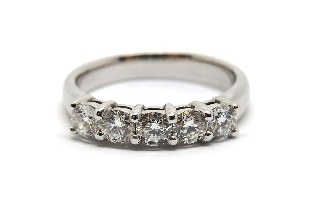 Shared claw brilliant cut diamond ring