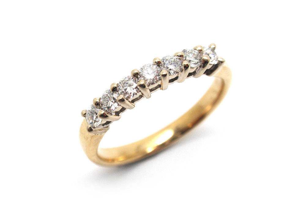 Share claw brilliant cut diamond white gold setting with a yellow gold band