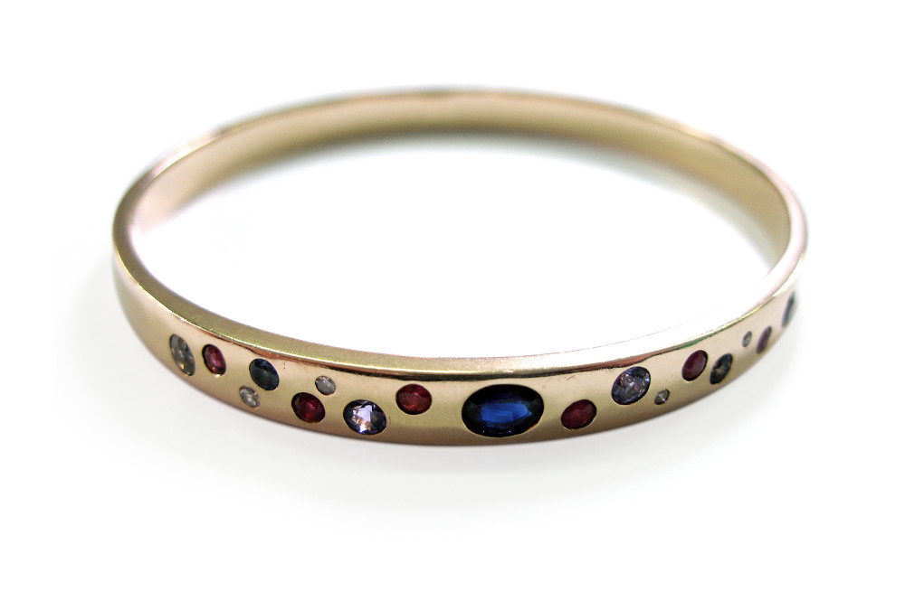 Melted down old gold bangle with customers sapphire and other gemstones hammer set