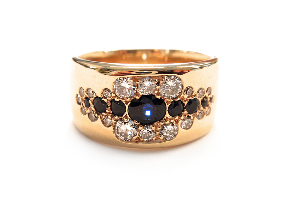 Blue sapphires and diamond pave set dress ring in wide tapering band