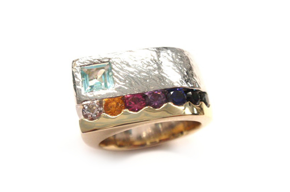 Multi coloured round cut sapphires with light blue topaz square