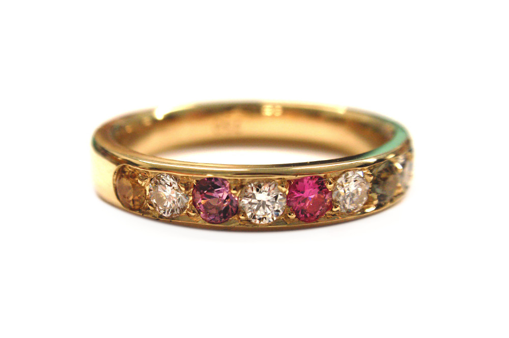 Multiple coloured sapphire and diamond pave set band