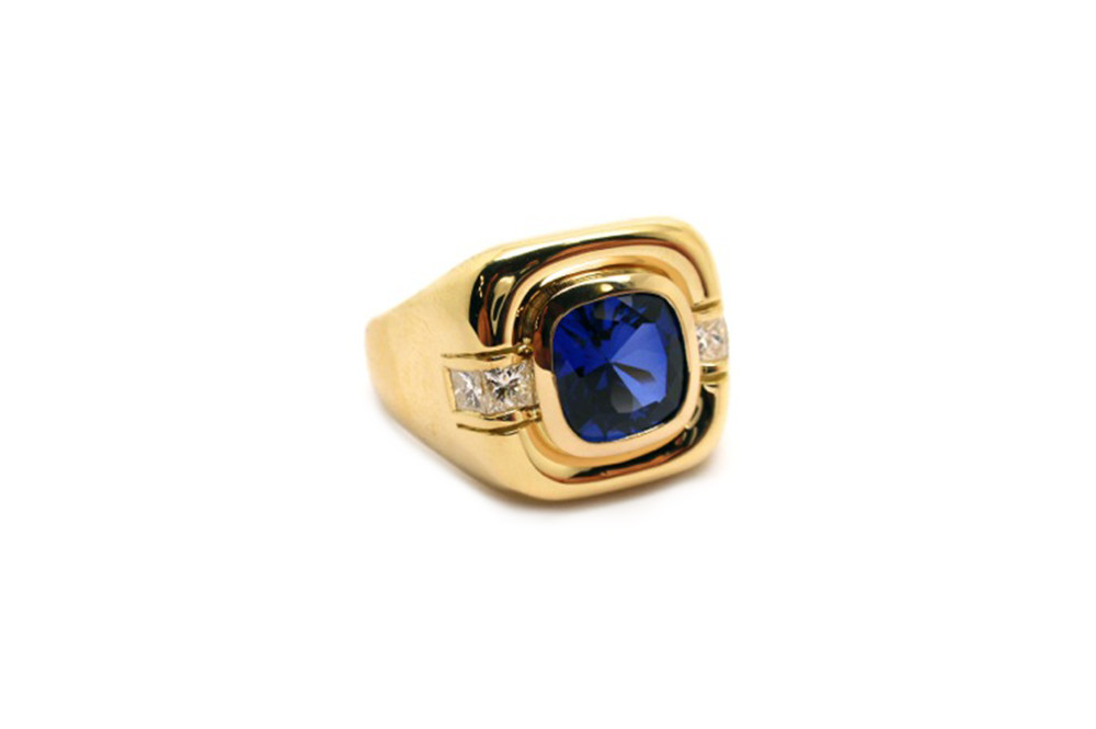 Cushion cut sapphire mens ring with channel set princes cut diamonds on the shoulders