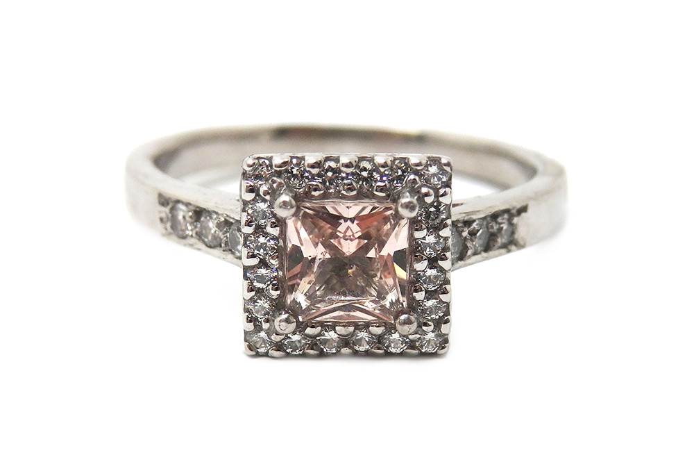 Pink sapphire squad cut with a surrounding halo and band of diamonds bead set
