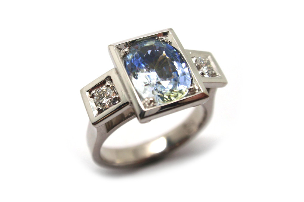 Party sapphire bead set in a rectangle framed with side diamonds in a white gold ring