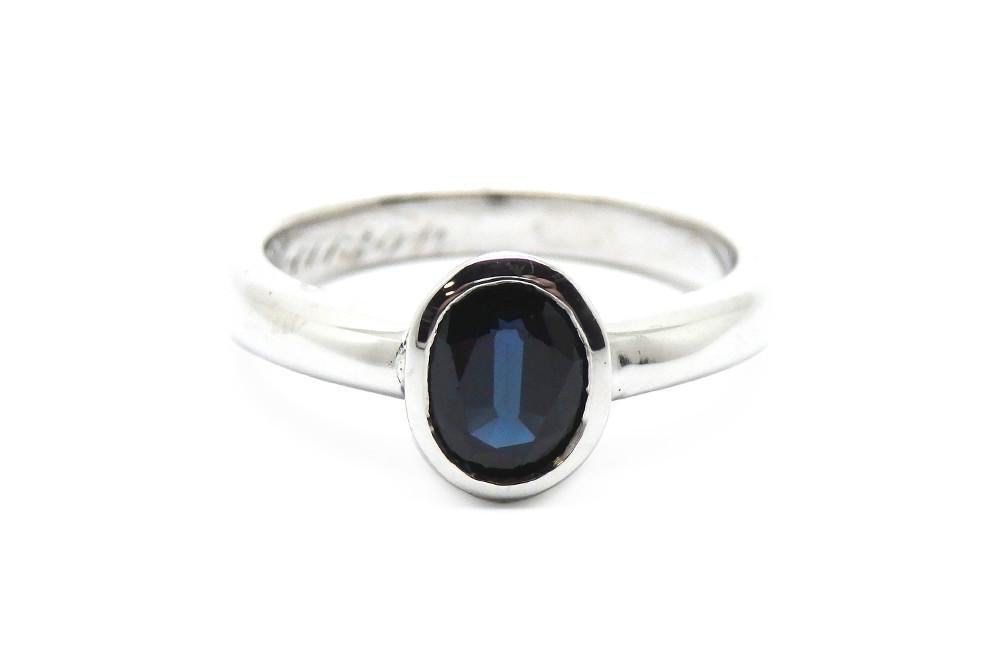Bezel set deep blue oval sapphire ring