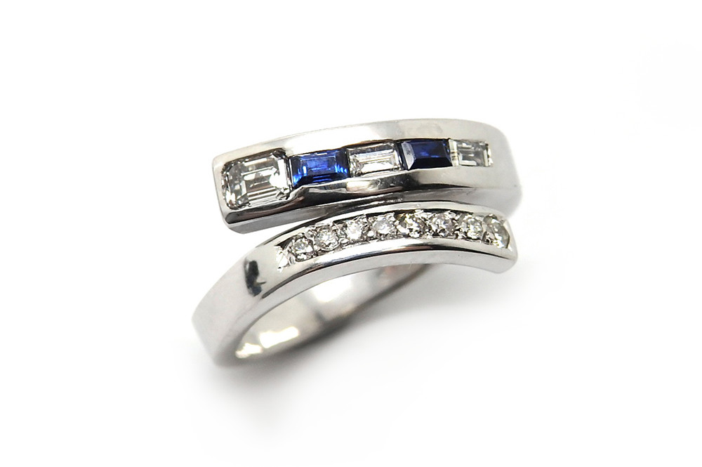 Blue sapphire and diamond cross over ring