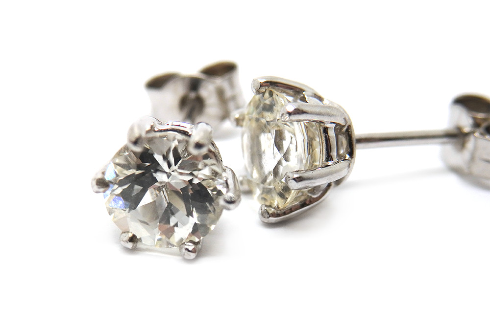 White sapphire round cut set in white gold stud earrings