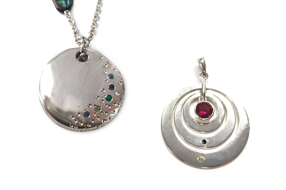 Friends pendants, by using everyone's birthstones set into a pendant