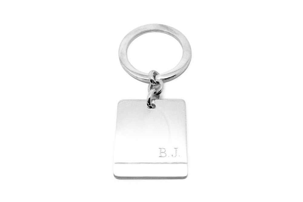 A hand carved keyring with hand engraved initials