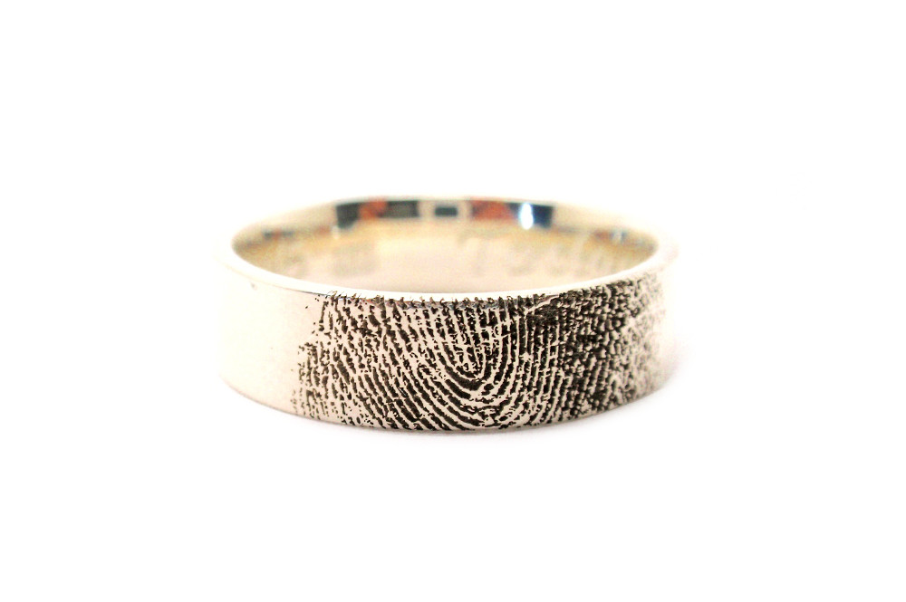 Laser engraved wedding ring, from an ink print, the image can be reproduced on any metal surface