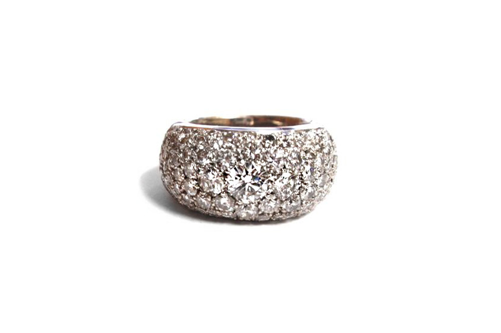 Various sized round diamonds pave set over domed white gold ring