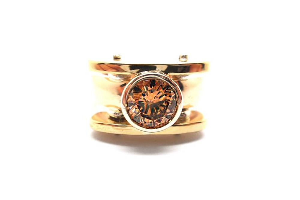 Champaign coloured round diamond bezel set in a three tone dress ring