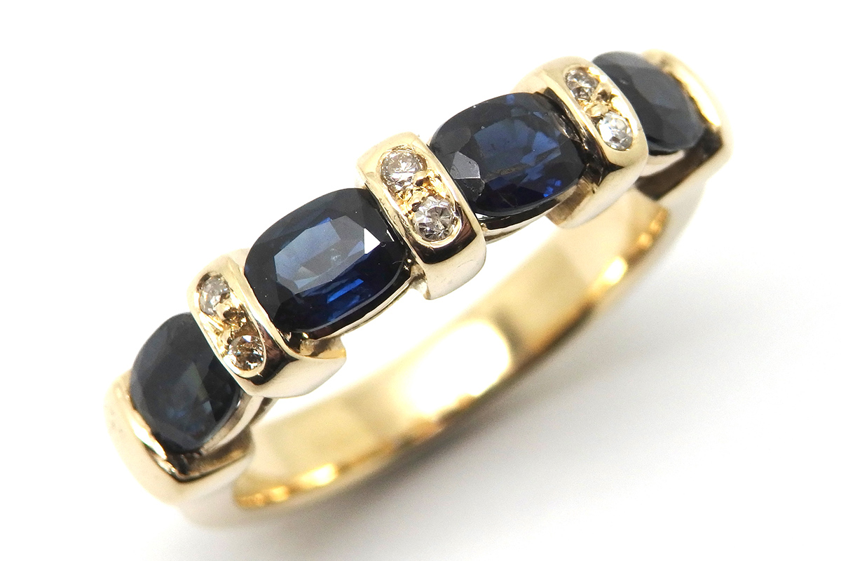 End set oval sapphire and diamond anniversary ring