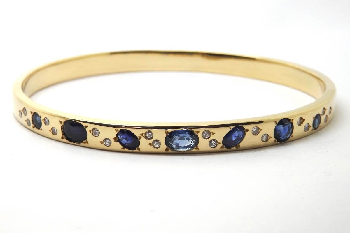 Sapphire and diamonds solid bangle