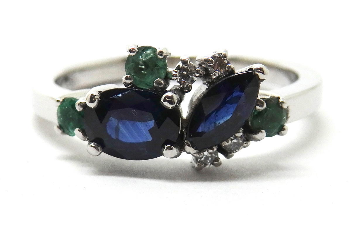 Sapphire emeralds and diamond claw set dress ring
