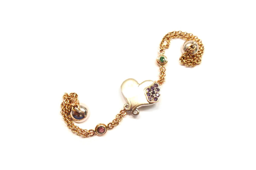 Three tone gold heart 10th anniversary bracelet with purple sapphires, tourmaline, emerald and magnetic clasp