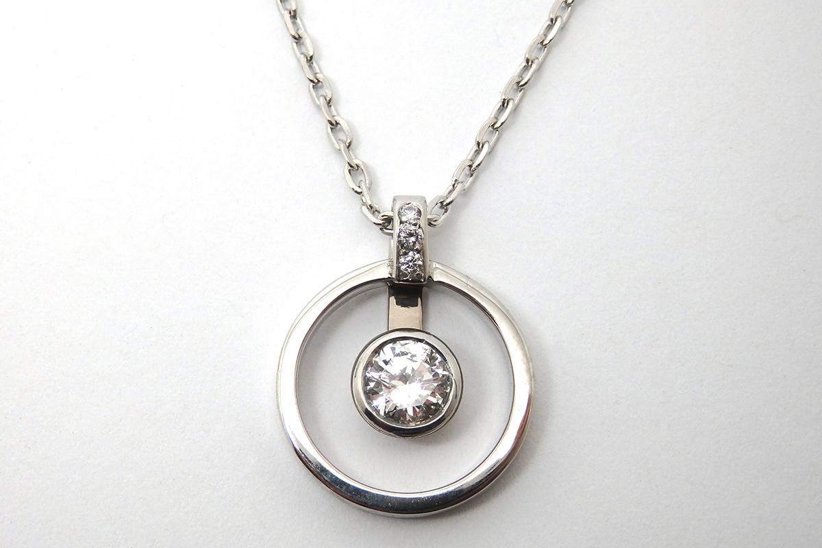 Bezel set diamond set inside an open ring