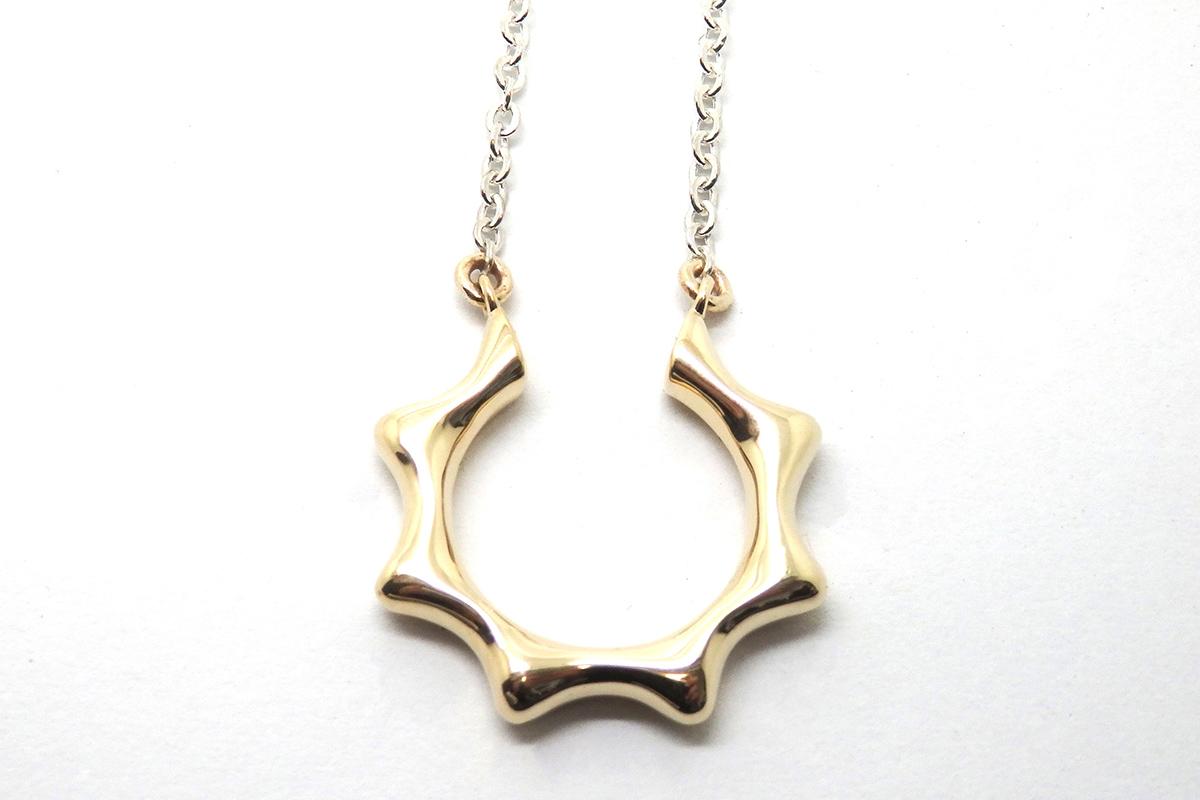 Open sun inspired pendant