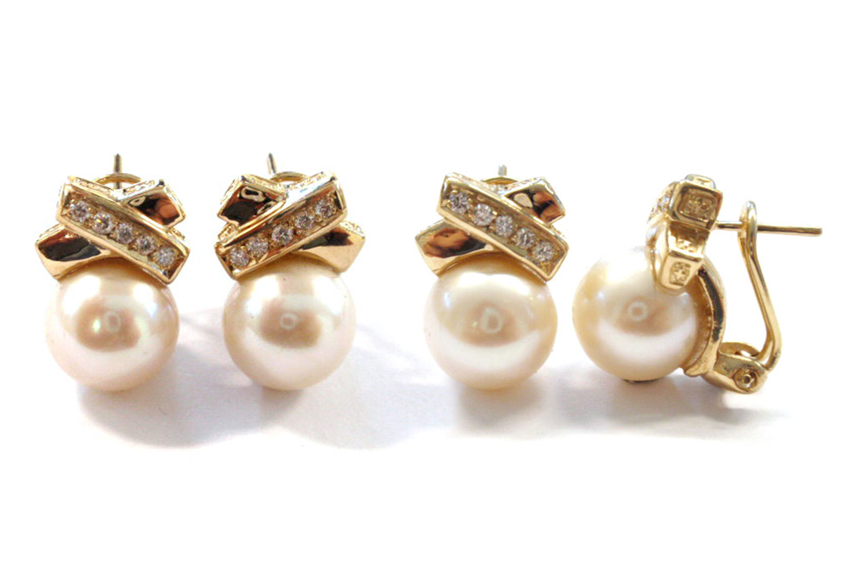 South sea pearls with a gold cross over section with diamond detail
