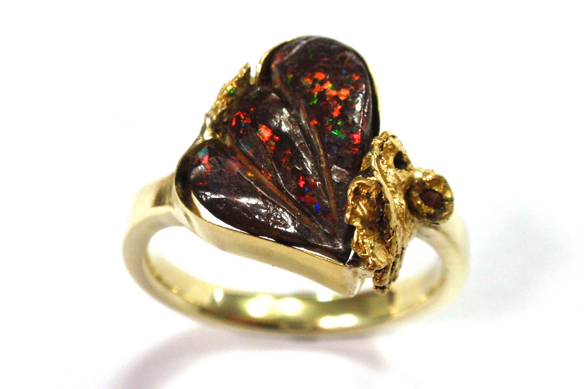 Boulder opal stylised wing with gold nugget in corner dress ring