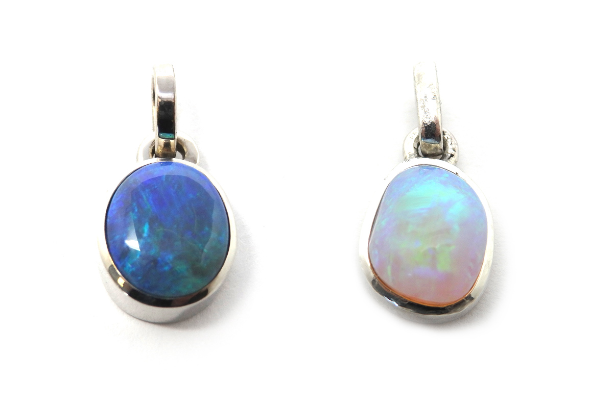 Crystal black opal and white opal bezel set pendants