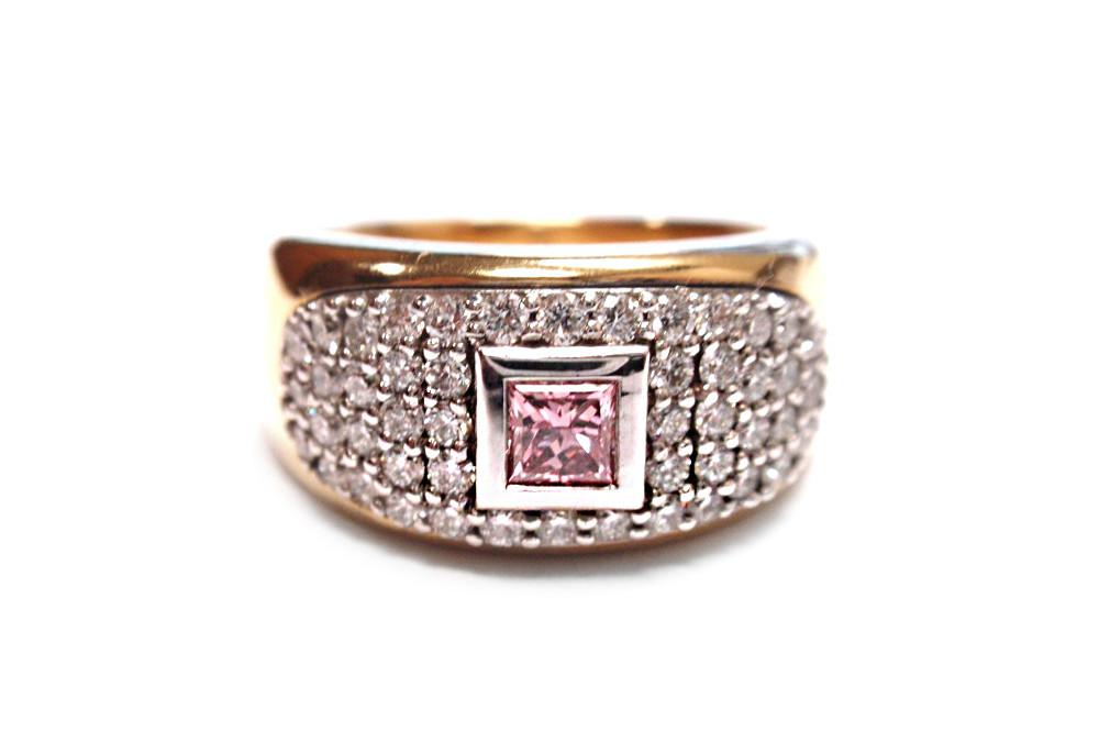 Princess cut pink diamond bezel surrounded by bead set brilliant cut diamonds inlayed into a yellow gold band