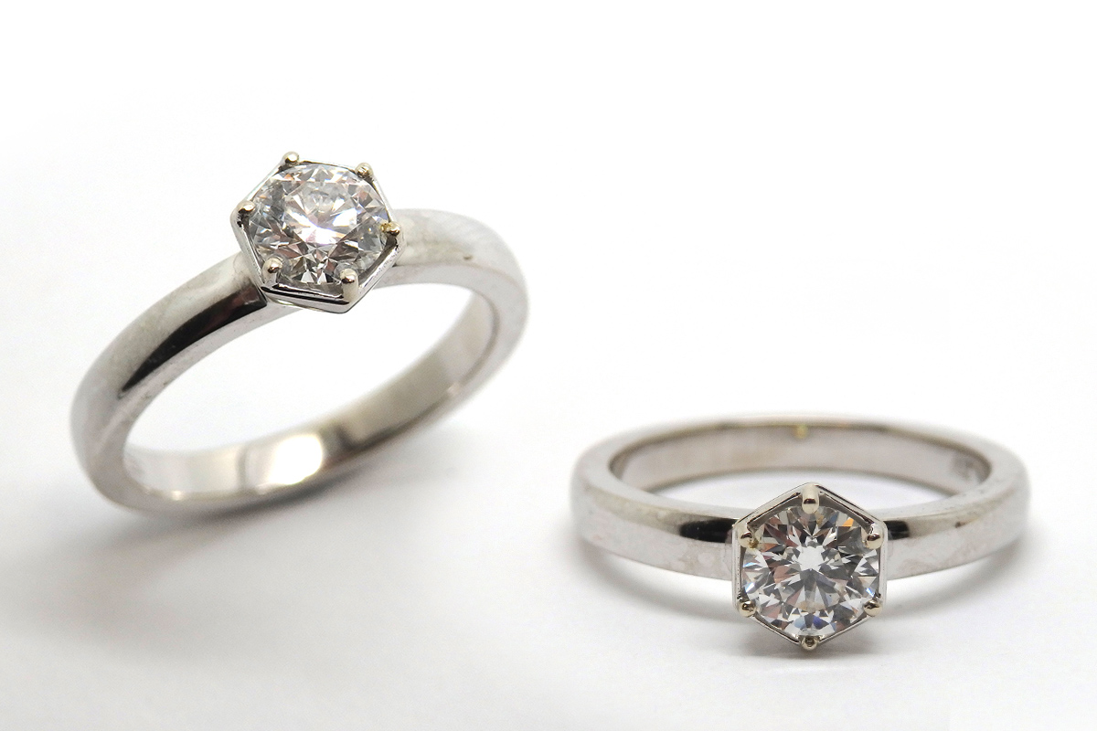 Hexagon shaped setting with a brilliant cut diamond solitaire ring