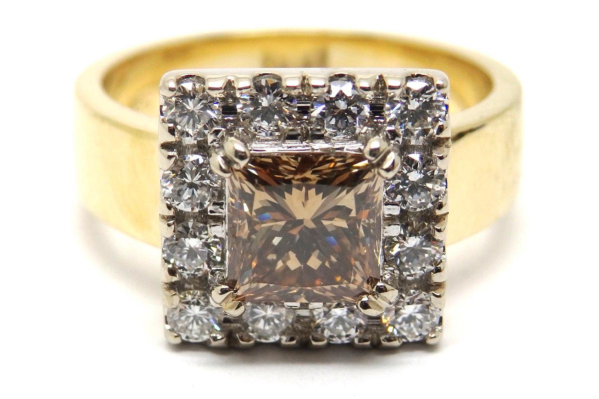 Argyle champagne diamond surrounded by white diamonds ring