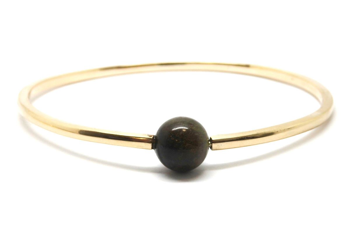Opening gold bangle with gold obsidian bead