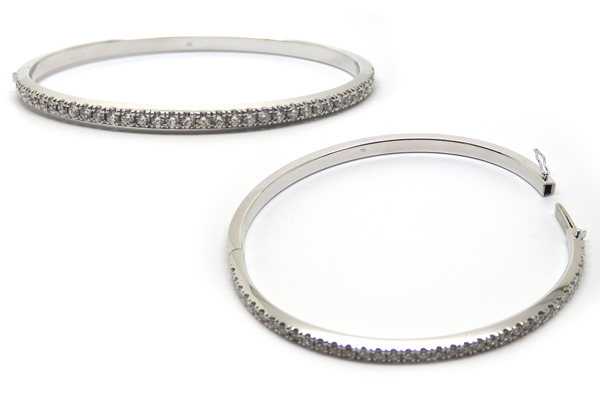 Handmade oval white gold diamond claw set opening bangle