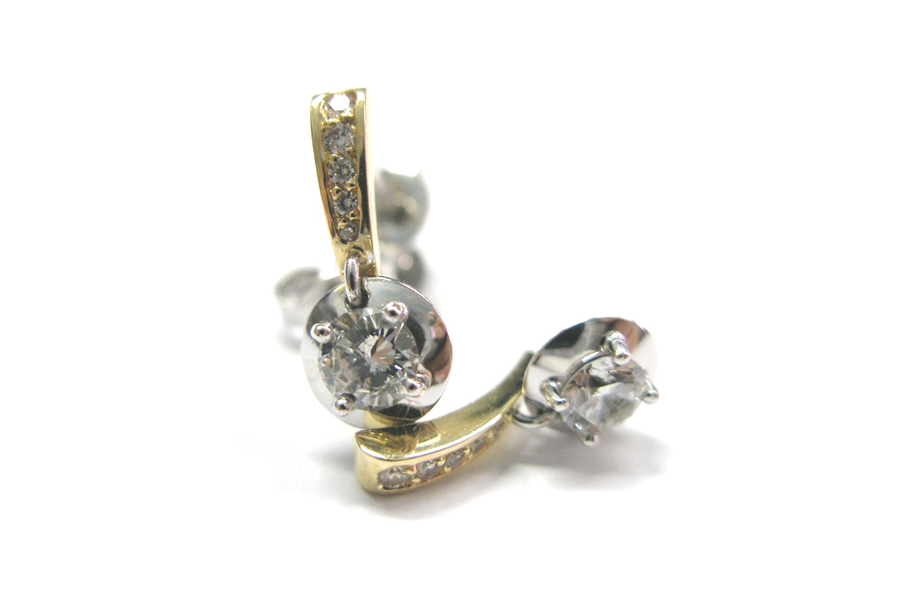 Brilliant cut diamonds claw and pave set into two tone moving earring