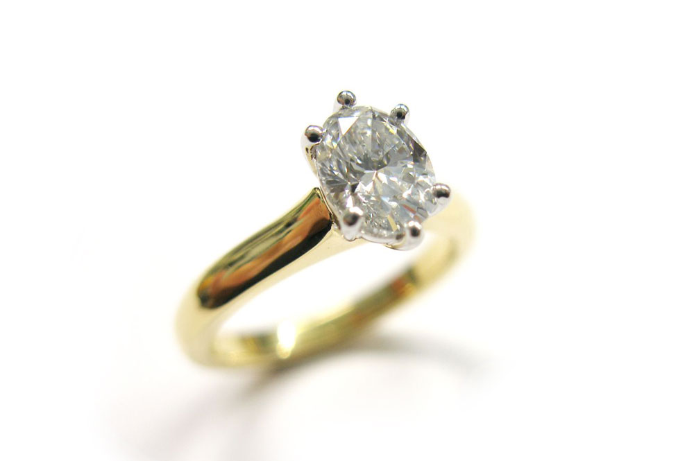 Oval diamond set in a six claw setting and a tapering band