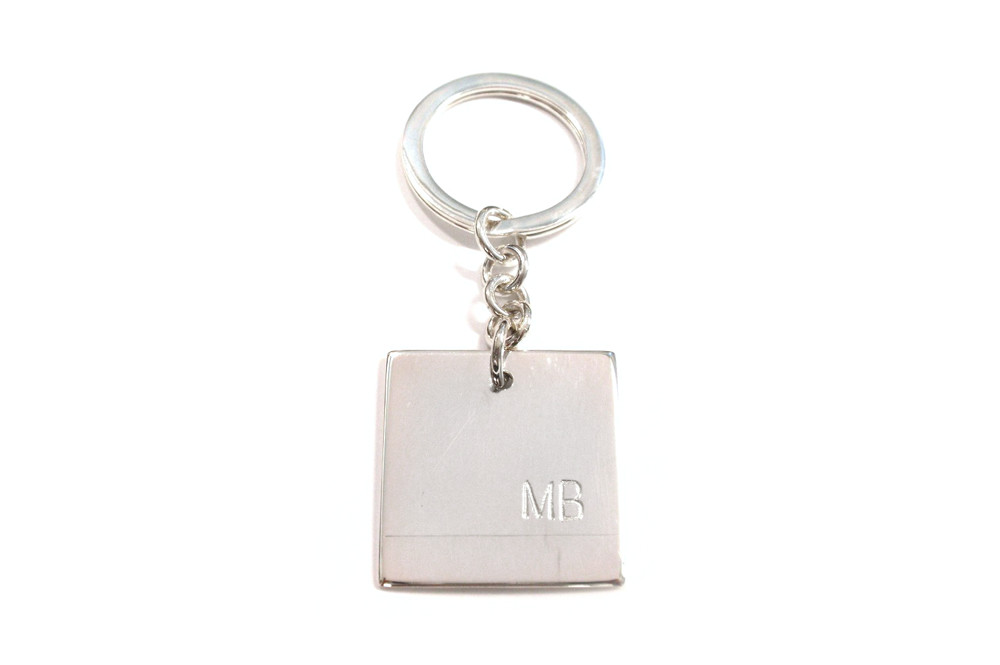 Hand engraved initials on plate key ring