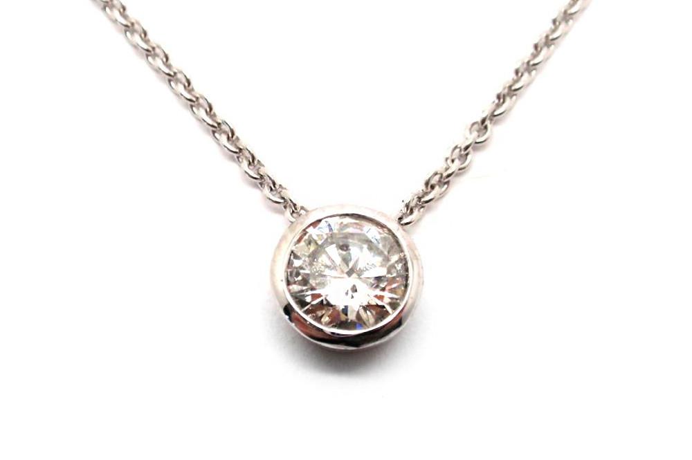 Brilliant cut round diamond bezel set floating pendant