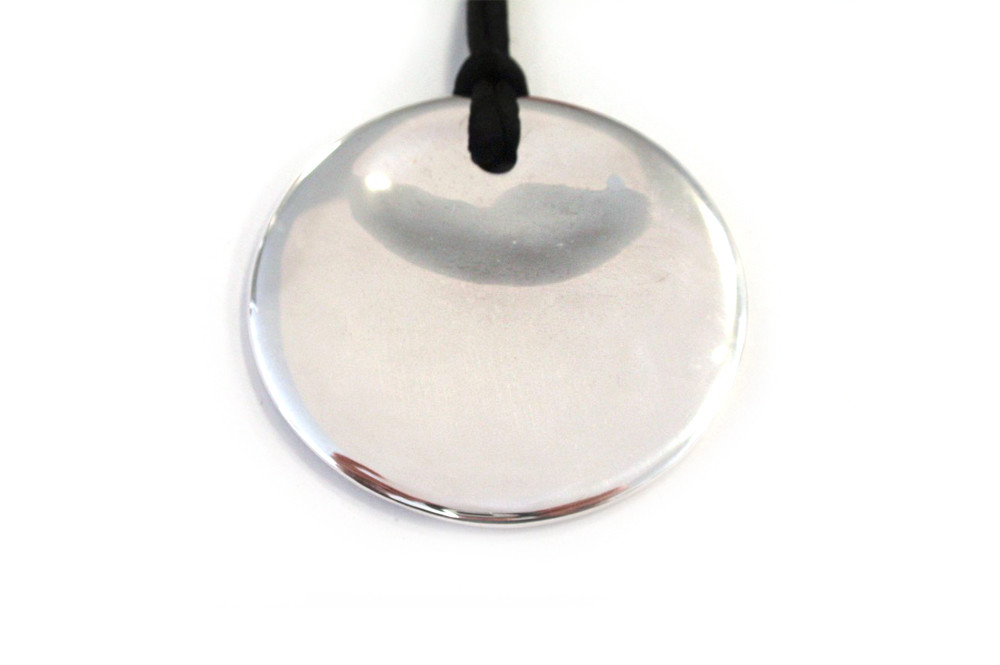 Solid silver hand carved disc pendant